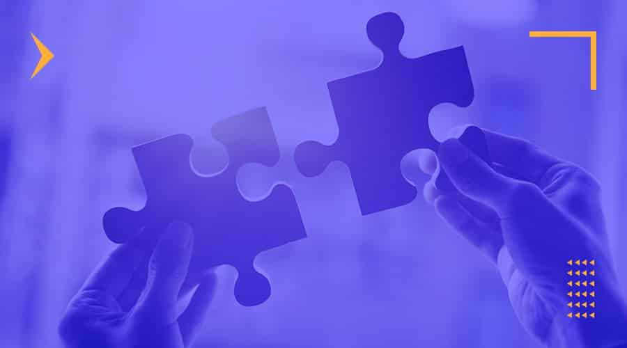 A person holding two pieces of a puzzle to represent corporate branding and all its elements that need to fit together